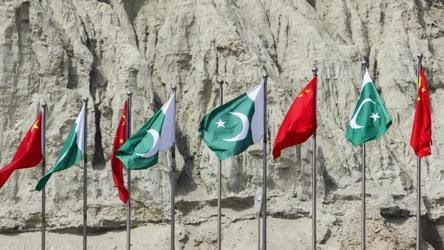 Chinas national flags fly next to Pakistans national flags at the Gwadar port in Balochistan Pakistan on July 4 2018